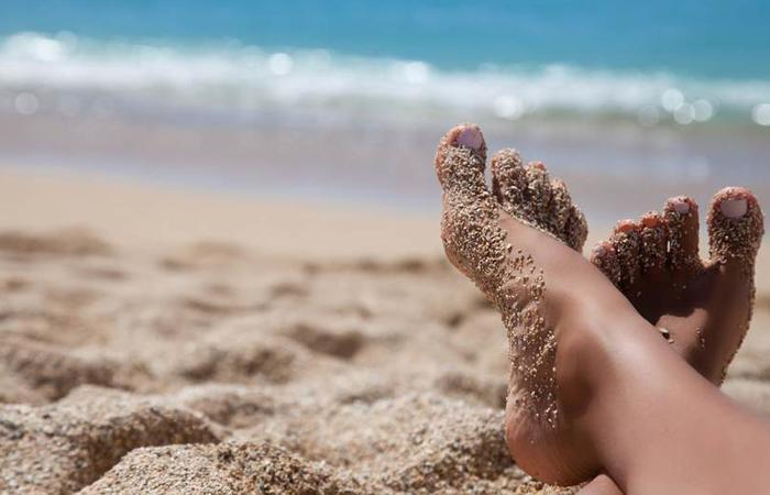 feet in the sand.jpg.838x0 q67 crop smart